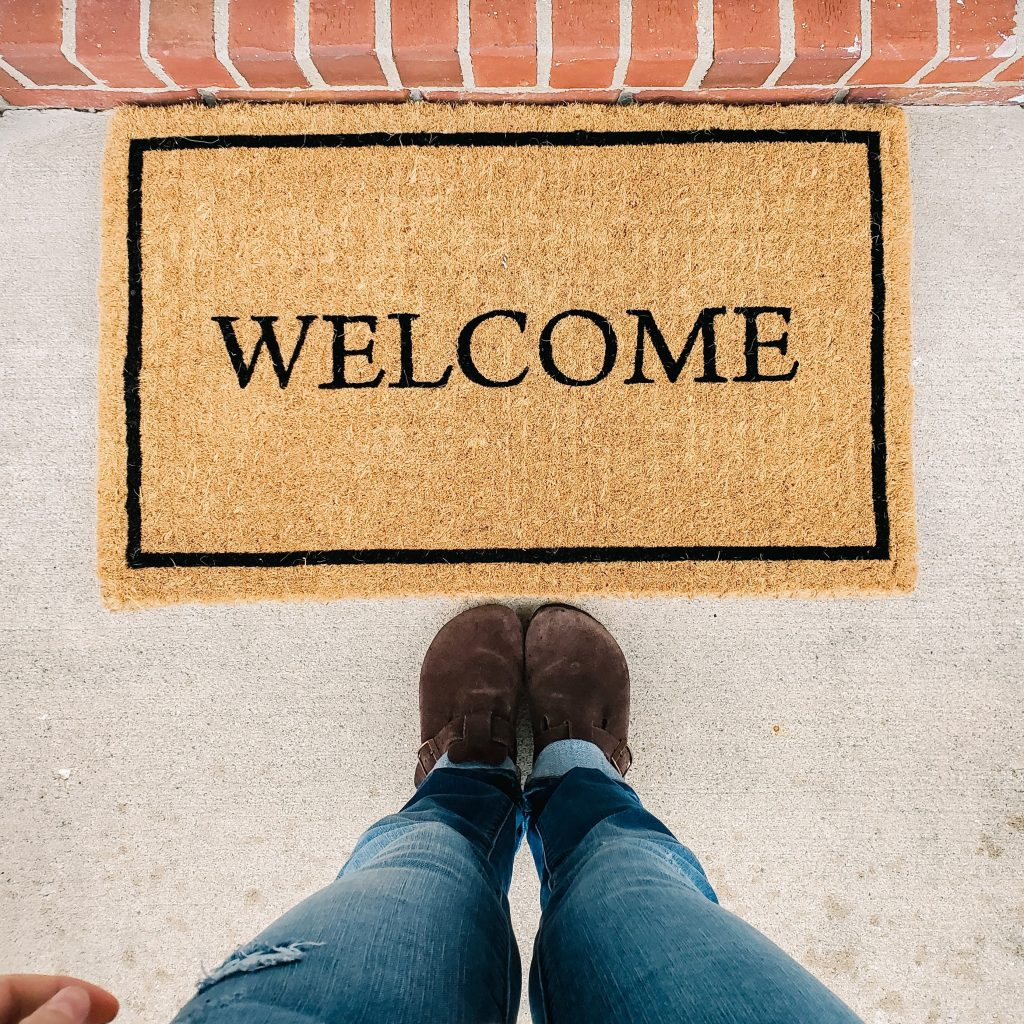 spring cleaning home maintenance check list replace welcome mats with new springtime decor