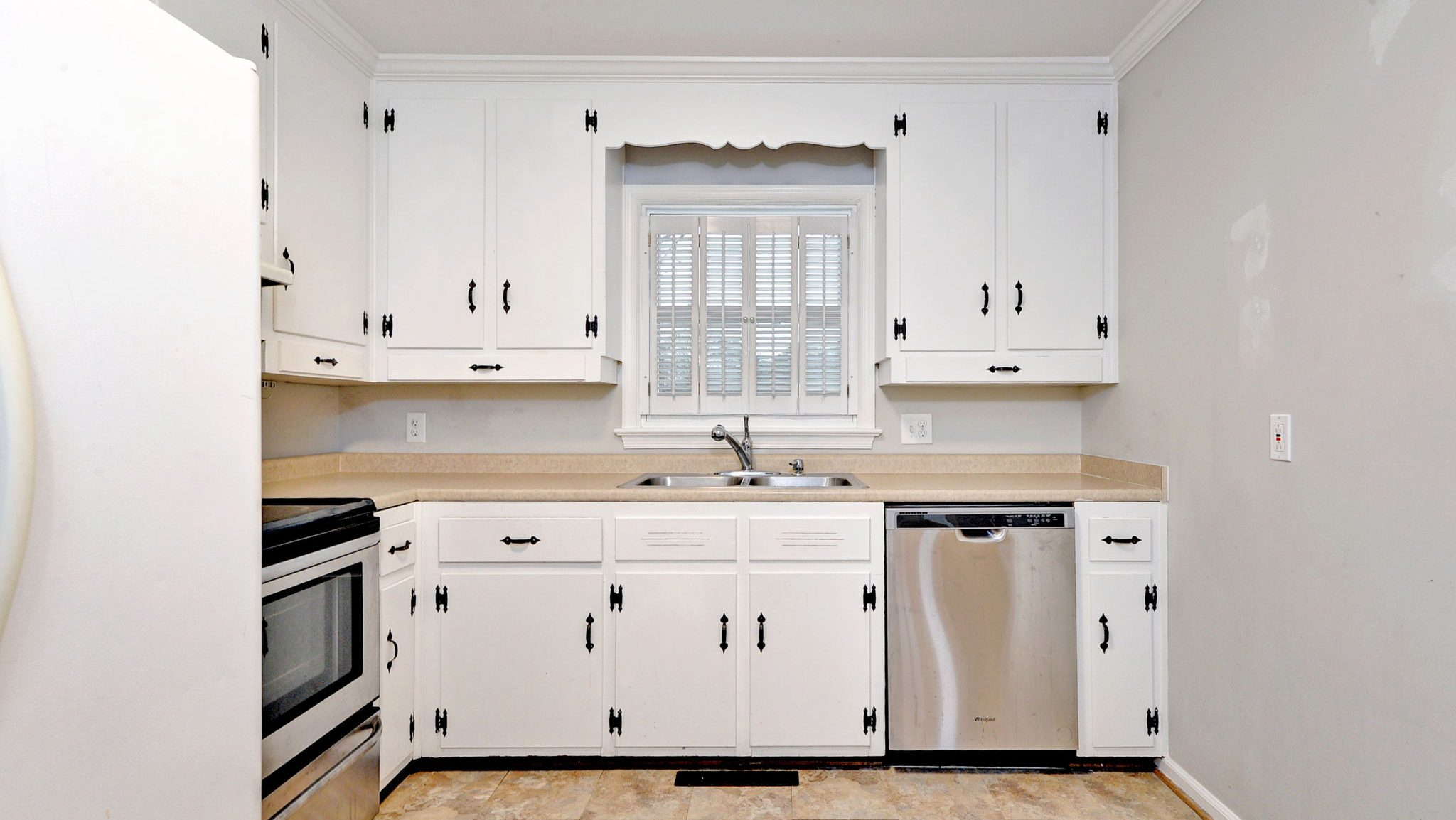 professional real estate photographer capturing white kitchen with new cabinets in new listing in newport news virginia