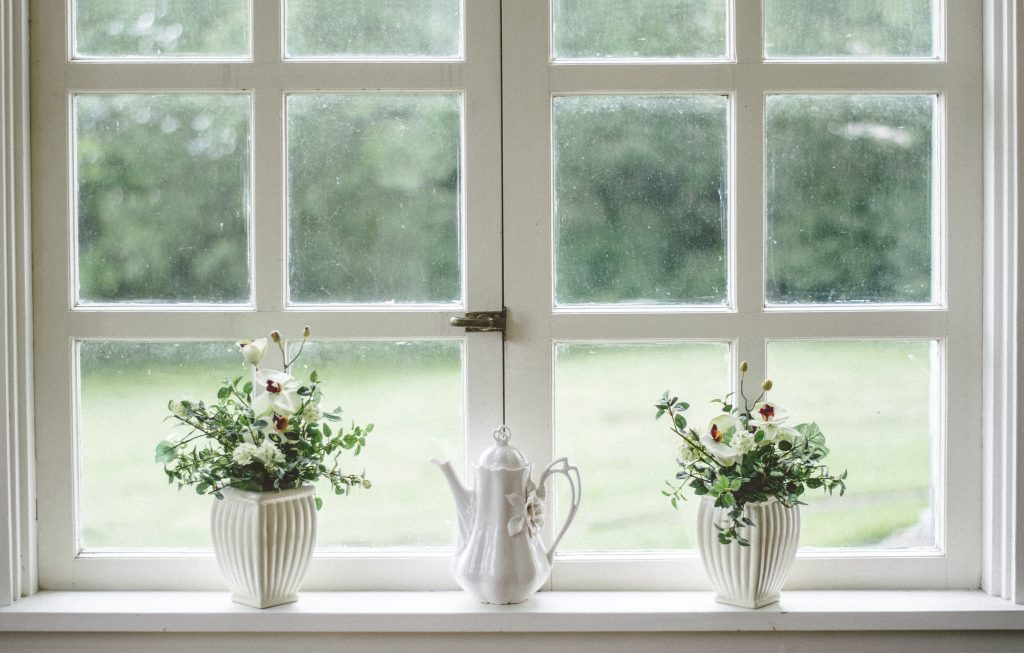 spring cleaning home maintenance for homeowners clean inside and outside of windows, repair or replace window screens